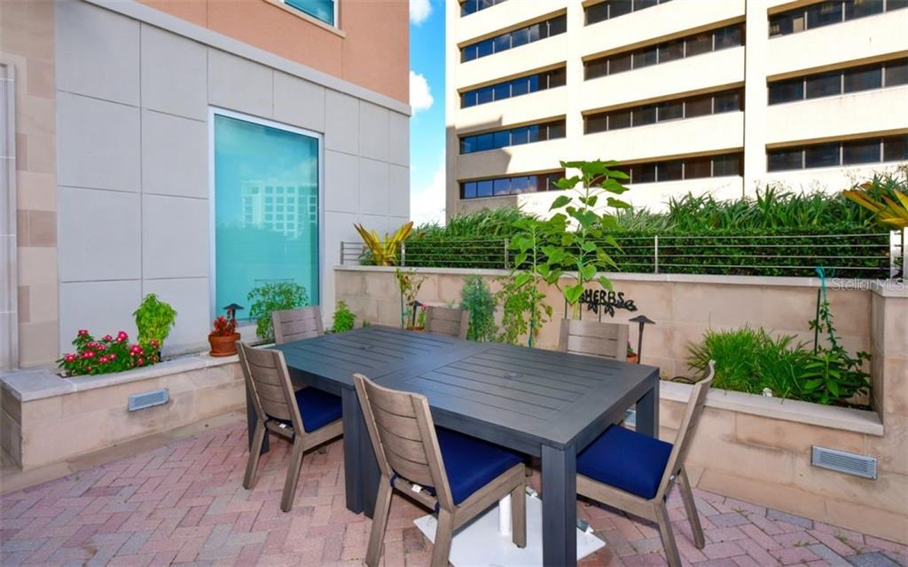 Eating area and herb garden - Condo for sale at 1350 Main St #701, Sarasota, FL 34236 - MLS Number is A4472236