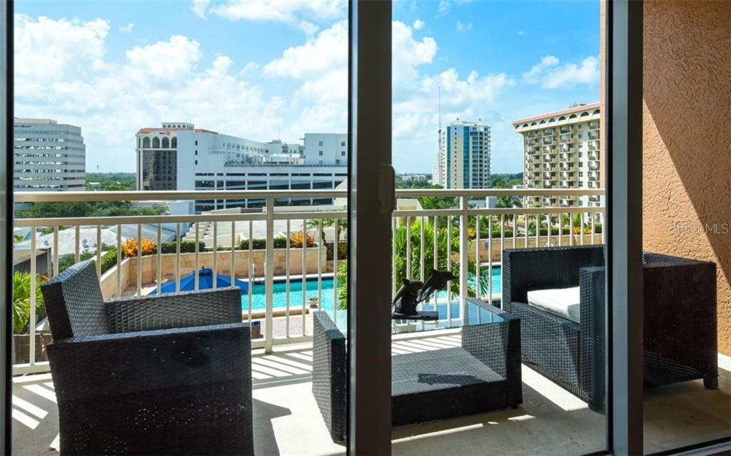 Terrace off the great room that overlooks the pool deck and the city - Condo for sale at 1350 Main St #701, Sarasota, FL 34236 - MLS Number is A4472236