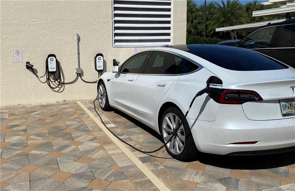 Two charging stations for your electric vehicle as well as free car wash with a vacuum and air hose. - Condo for sale at 5770 Midnight Pass Rd #509c, Sarasota, FL 34242 - MLS Number is A4472645