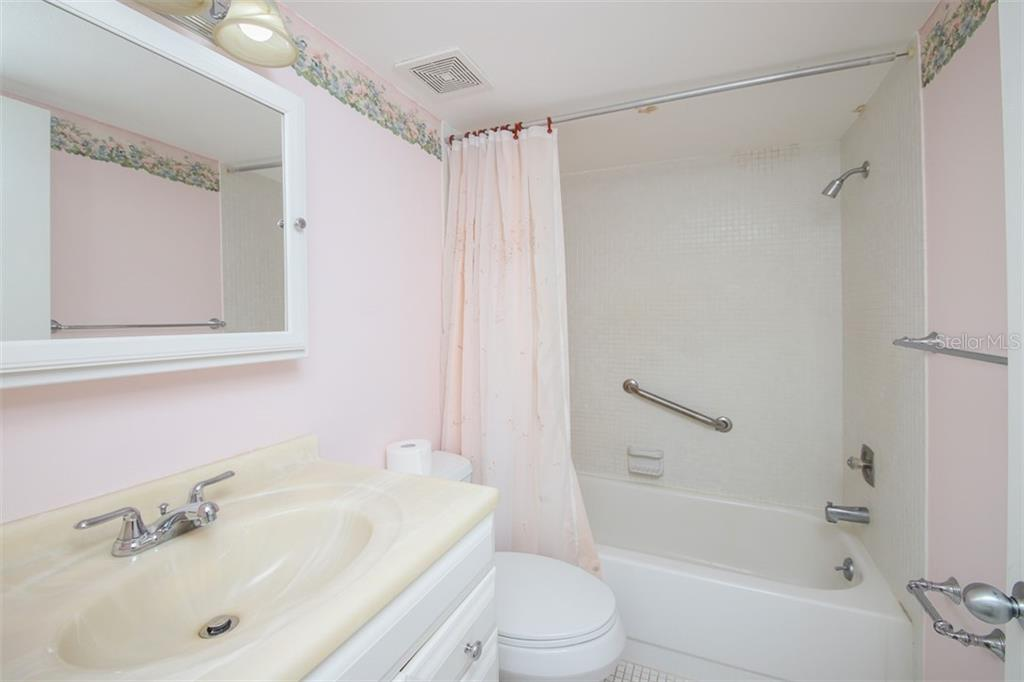 Master bath with ergonomic height vanity. Note grab bar. - Condo for sale at 1330 Glen Oaks Dr E #171d, Sarasota, FL 34232 - MLS Number is A4473999