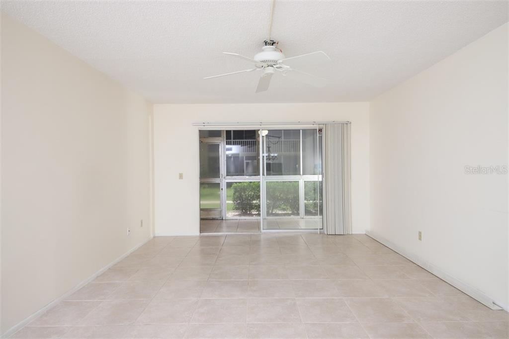Living space looking S to lanai and green space between buildings. - Condo for sale at 1330 Glen Oaks Dr E #171d, Sarasota, FL 34232 - MLS Number is A4473999