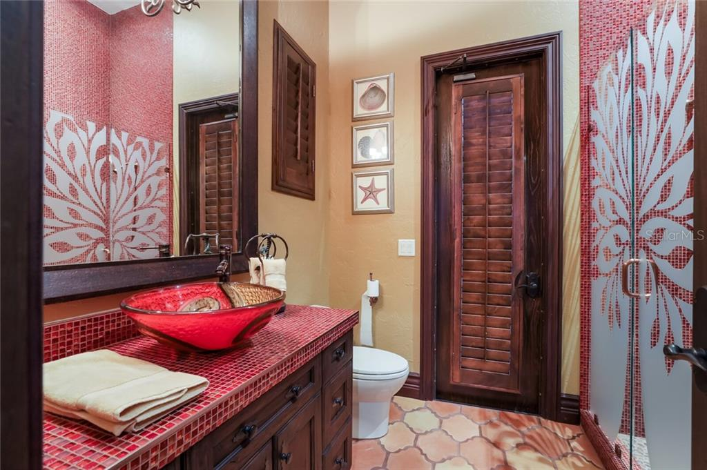 Guest cabana ensuite bathroom. - Single Family Home for sale at 4925 Topsail Dr, Nokomis, FL 34275 - MLS Number is A4475116