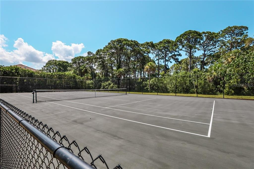 Private tennis court. - Single Family Home for sale at 4925 Topsail Dr, Nokomis, FL 34275 - MLS Number is A4475116
