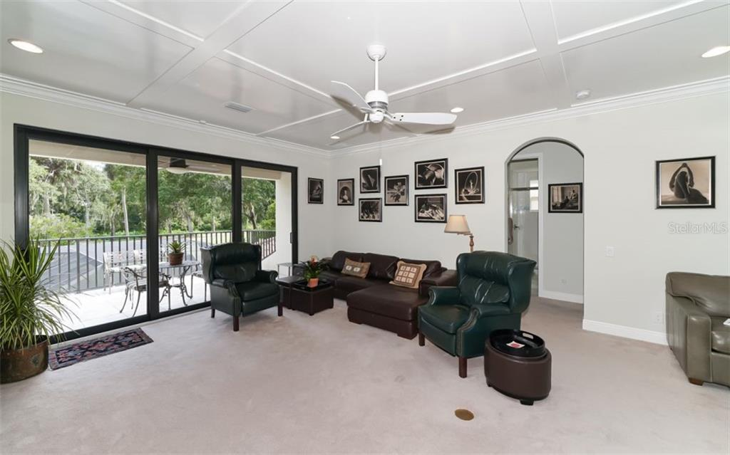 Second floor family room.  with sliding doors to the balcony - Single Family Home for sale at 3538 Trebor Ln, Sarasota, FL 34235 - MLS Number is A4475545