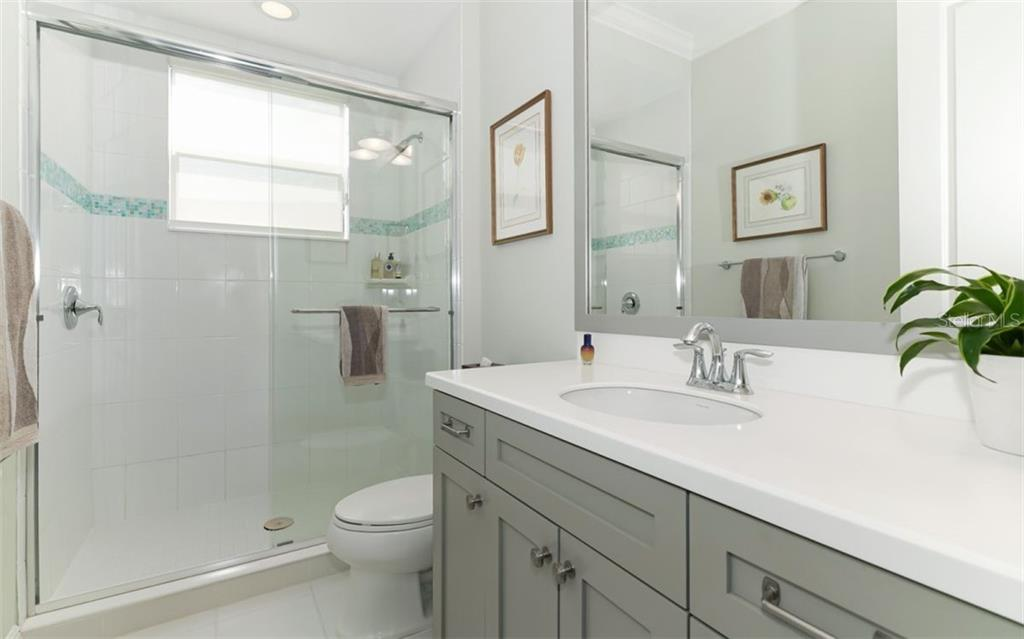 Full bath on second floor, between bedroom 3 and bedroom 4    East facing window - Single Family Home for sale at 3538 Trebor Ln, Sarasota, FL 34235 - MLS Number is A4475545