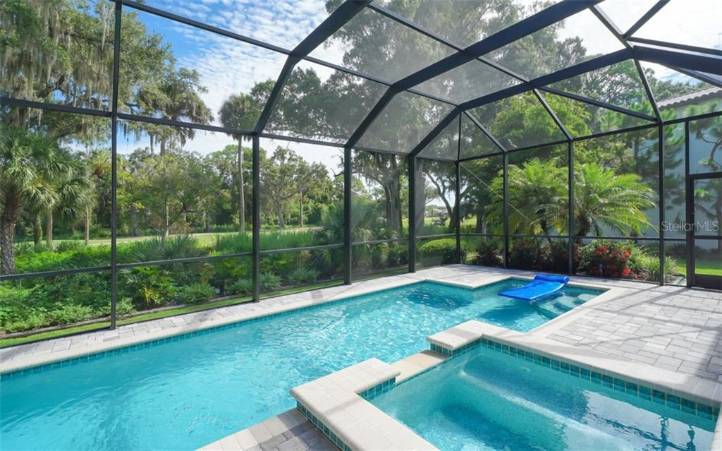37 Ft Lap pool with splash area and separate spa - Single Family Home for sale at 3538 Trebor Ln, Sarasota, FL 34235 - MLS Number is A4475545