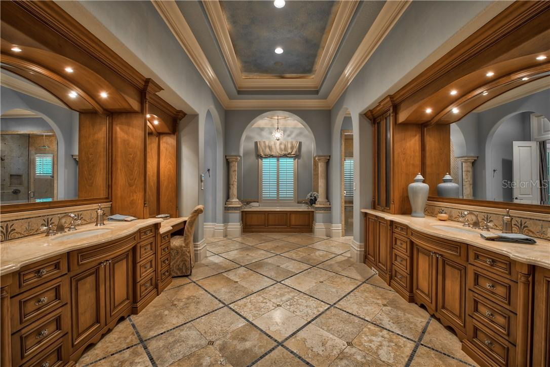 Master Bathroom with Luxurious Tile Detailing Throughout - Single Family Home for sale at 8499 Lindrick Ln, Bradenton, FL 34202 - MLS Number is A4475594