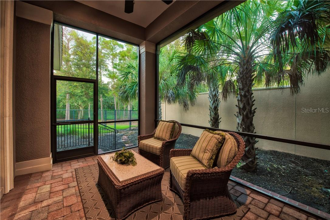 Private Lanai off Guest Apartment - Single Family Home for sale at 8499 Lindrick Ln, Bradenton, FL 34202 - MLS Number is A4475594