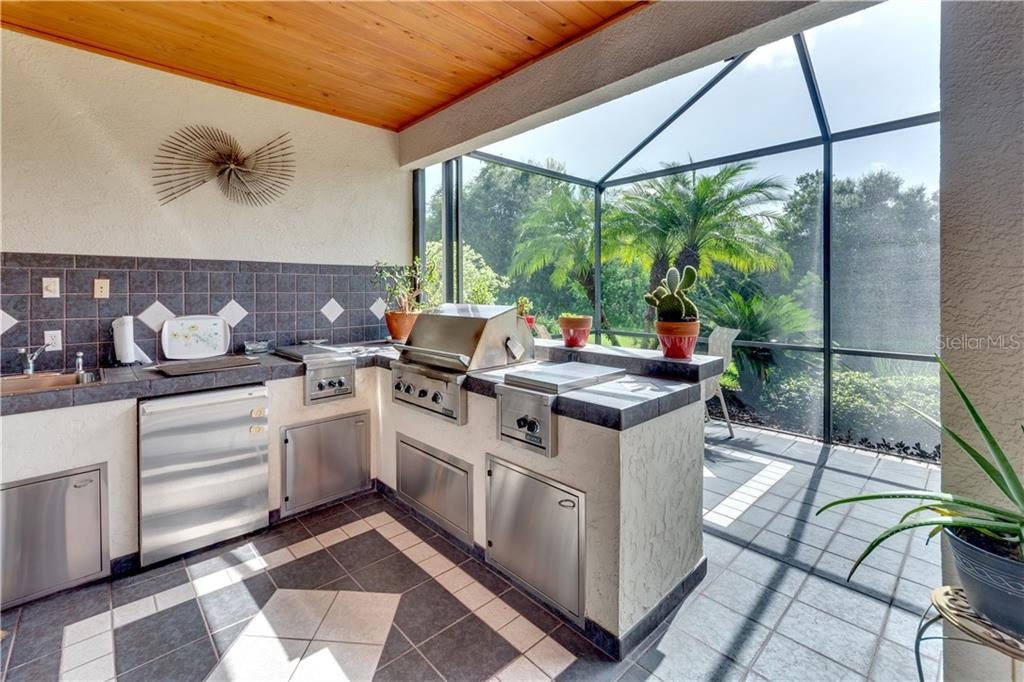 Outdoor kitchen/lanai - Single Family Home for sale at 701 Misty Pond Ct, Bradenton, FL 34212 - MLS Number is A4476203