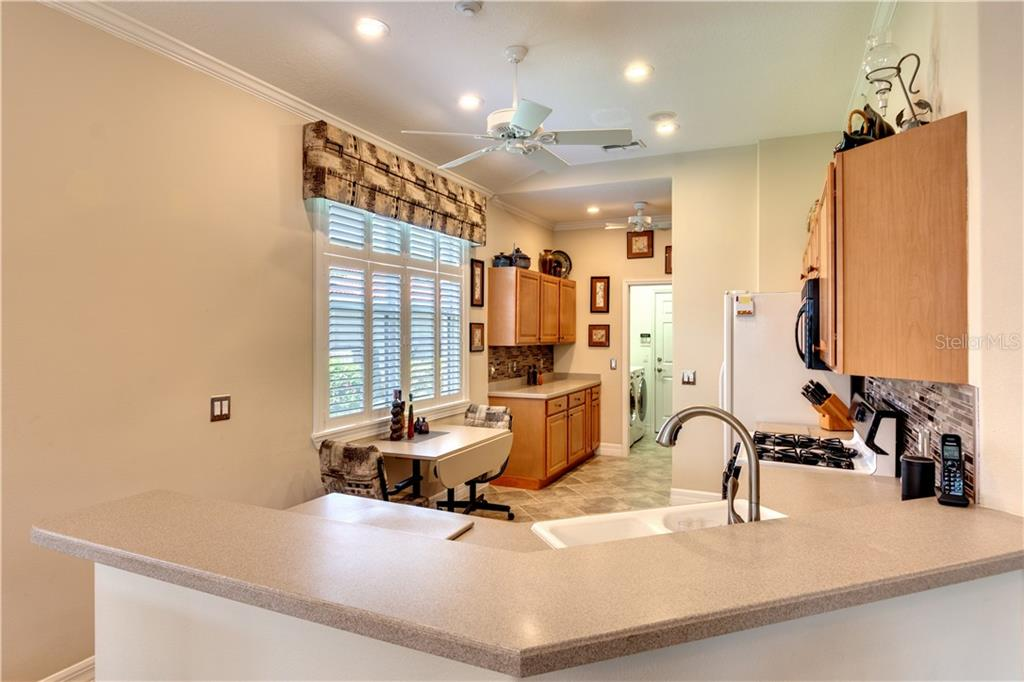 Kitchen - Single Family Home for sale at 701 Misty Pond Ct, Bradenton, FL 34212 - MLS Number is A4476203