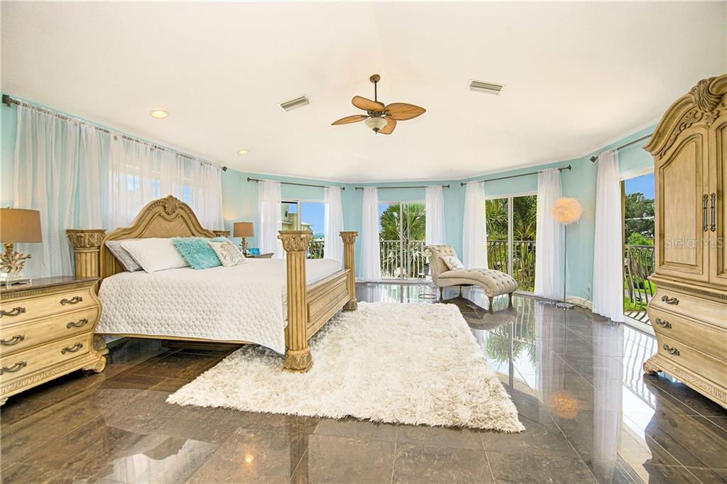 Master bedroom with 5 sliding glass doors, one balcony. - Single Family Home for sale at 7303 Westmoreland Dr, Sarasota, FL 34243 - MLS Number is A4478376