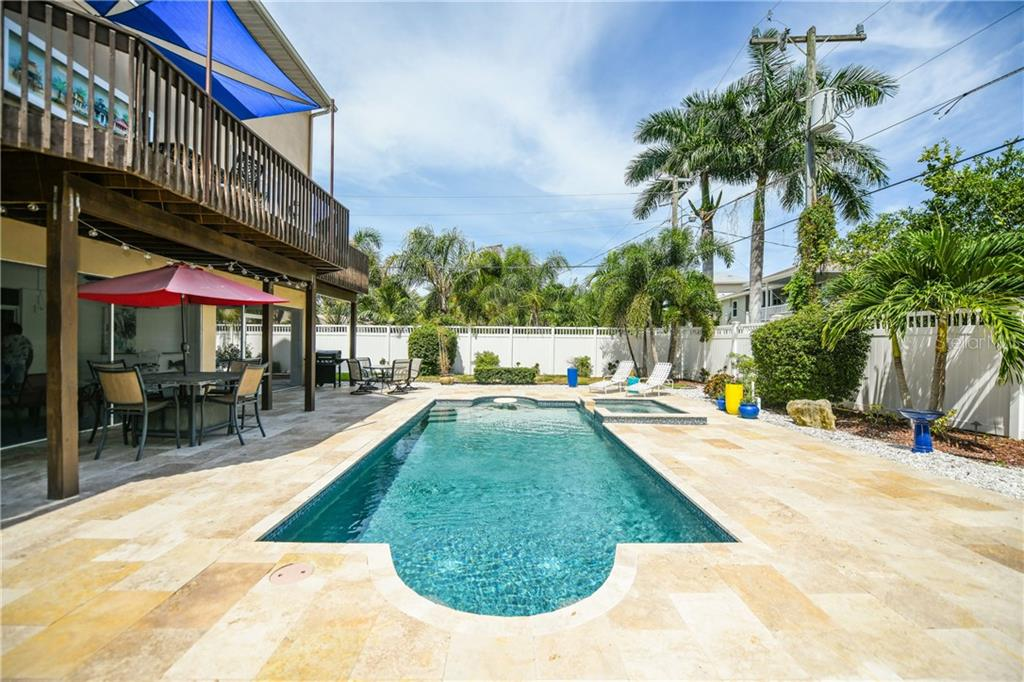 Pool/spa with travertine patio.  Second floor deck. - Single Family Home for sale at 7303 Westmoreland Dr, Sarasota, FL 34243 - MLS Number is A4478376