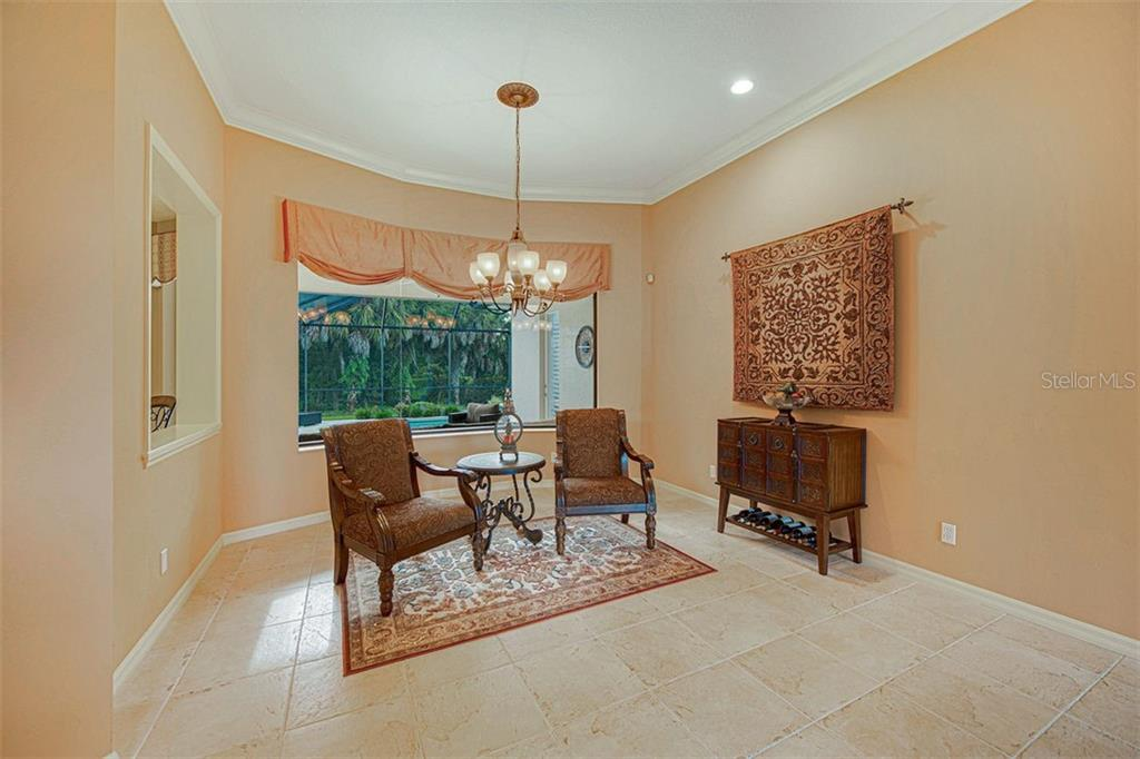 Living room with aquarium window for expansive views. - Single Family Home for sale at 684 Crane Prairie Way, Osprey, FL 34229 - MLS Number is A4478575