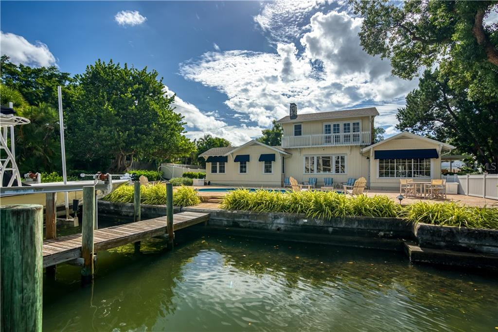 Sail Boat Depth Canal with Boat Dock and Lift - Single Family Home for sale at 1595 Bay Point Dr, Sarasota, FL 34236 - MLS Number is A4479218
