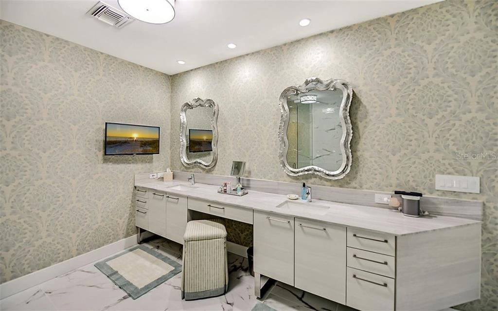 The master bath with dual sinks, make up table and ample storage - Condo for sale at 1155 N Gulfstream Ave #1701, Sarasota, FL 34236 - MLS Number is A4480090