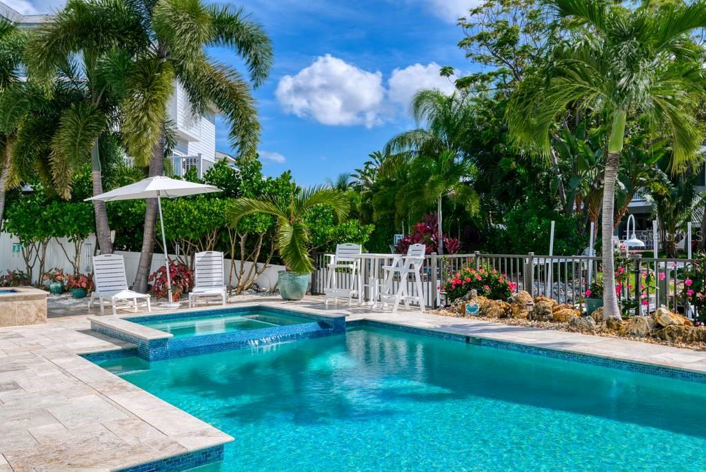 Propane heated saltwater pool and spa, propane fire pit to left. - Single Family Home for sale at 718 Key Royale Dr, Holmes Beach, FL 34217 - MLS Number is A4480381