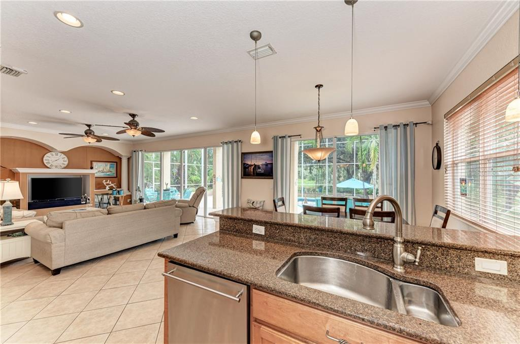 Breakfast bar for additional seating if needed - Single Family Home for sale at 7118 68th Dr E, Bradenton, FL 34203 - MLS Number is A4480398