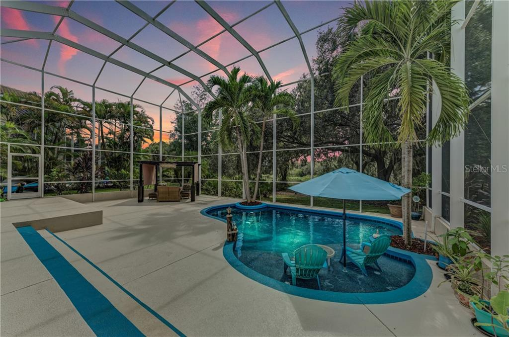 Romantic pool setting - Single Family Home for sale at 7118 68th Dr E, Bradenton, FL 34203 - MLS Number is A4480398