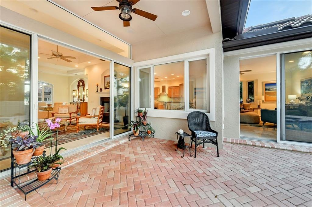 Sitting patios right off the formal & casual living spaces ! - Single Family Home for sale at 501 Cutter Ln, Longboat Key, FL 34228 - MLS Number is A4480484