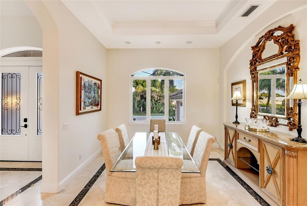 Large dining room with high coffered ceilings for all your elegant dinners! - Single Family Home for sale at 501 Cutter Ln, Longboat Key, FL 34228 - MLS Number is A4480484