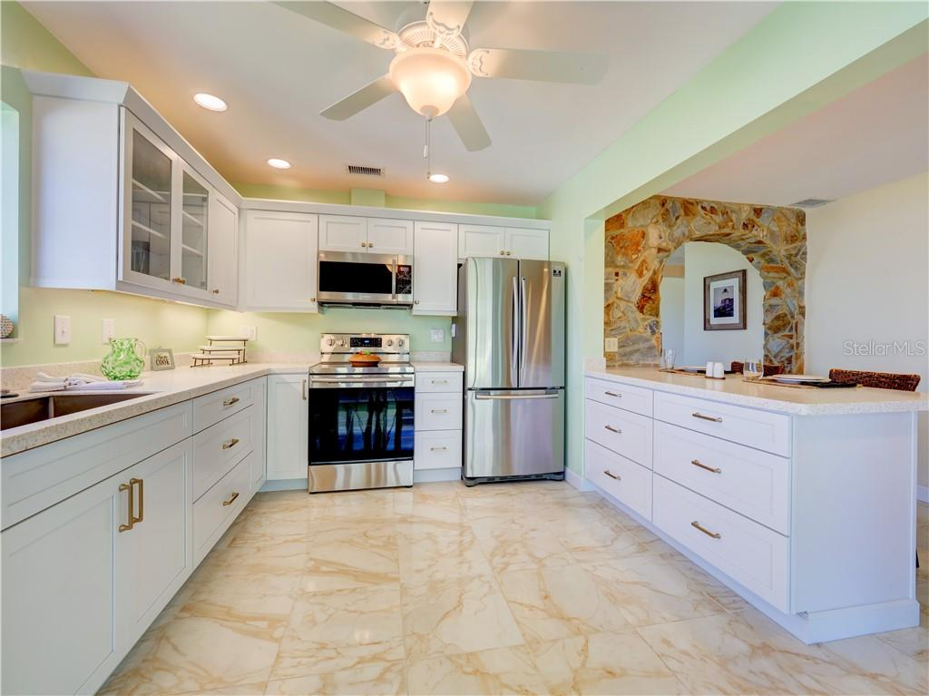 Light and bright white cabinets with plenty of drawers. - Single Family Home for sale at 2408 Riverside Dr E, Bradenton, FL 34208 - MLS Number is A4480609