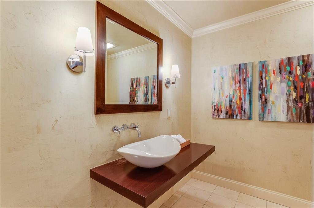 The chic Venetian-plaster-walled powder bath is conveniently located near the main living spaces. - Condo for sale at 1111 Ritz Carlton Dr #1506, Sarasota, FL 34236 - MLS Number is A4480943