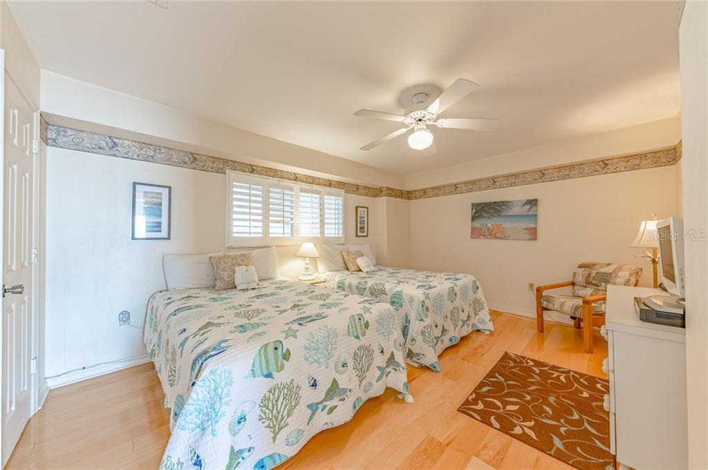 Bedroom 2 with walk-in closet - Condo for sale at 5830 Midnight Pass Rd #303, Sarasota, FL 34242 - MLS Number is A4481917