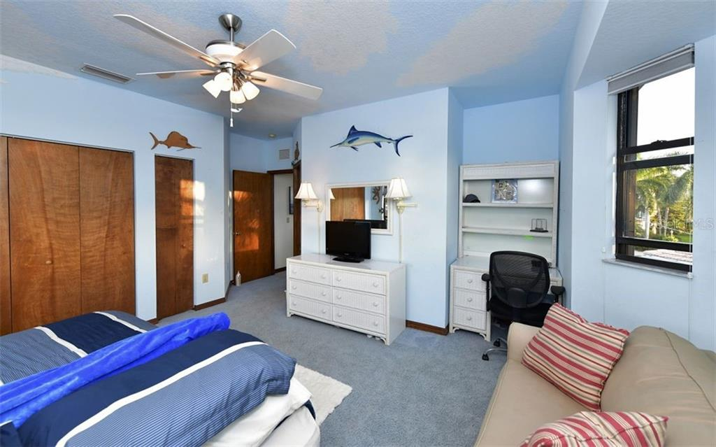 Bedroom 4 from windows looking at entrance to the suite - Single Family Home for sale at 9219 Bimini Dr, Bradenton, FL 34210 - MLS Number is A4483083