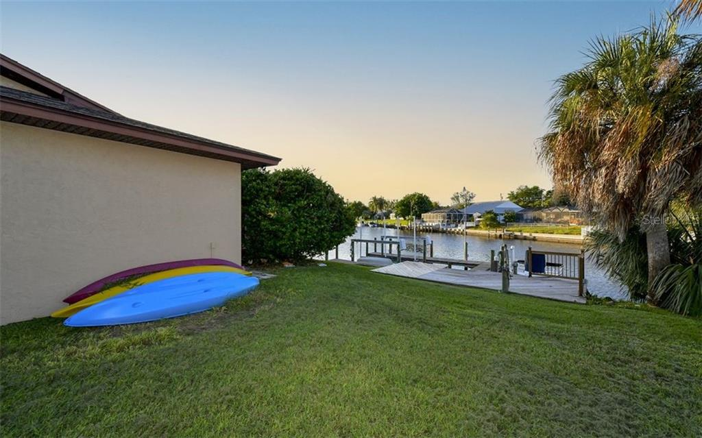 Platform deck and rail are newer-personal watercraft allowed in the water-just drop in off you dock. - Single Family Home for sale at 9219 Bimini Dr, Bradenton, FL 34210 - MLS Number is A4483083