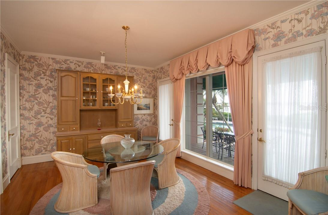 Breakfast room from family room. - Single Family Home for sale at Address Withheld, Sarasota, FL 34242 - MLS Number is A4483403