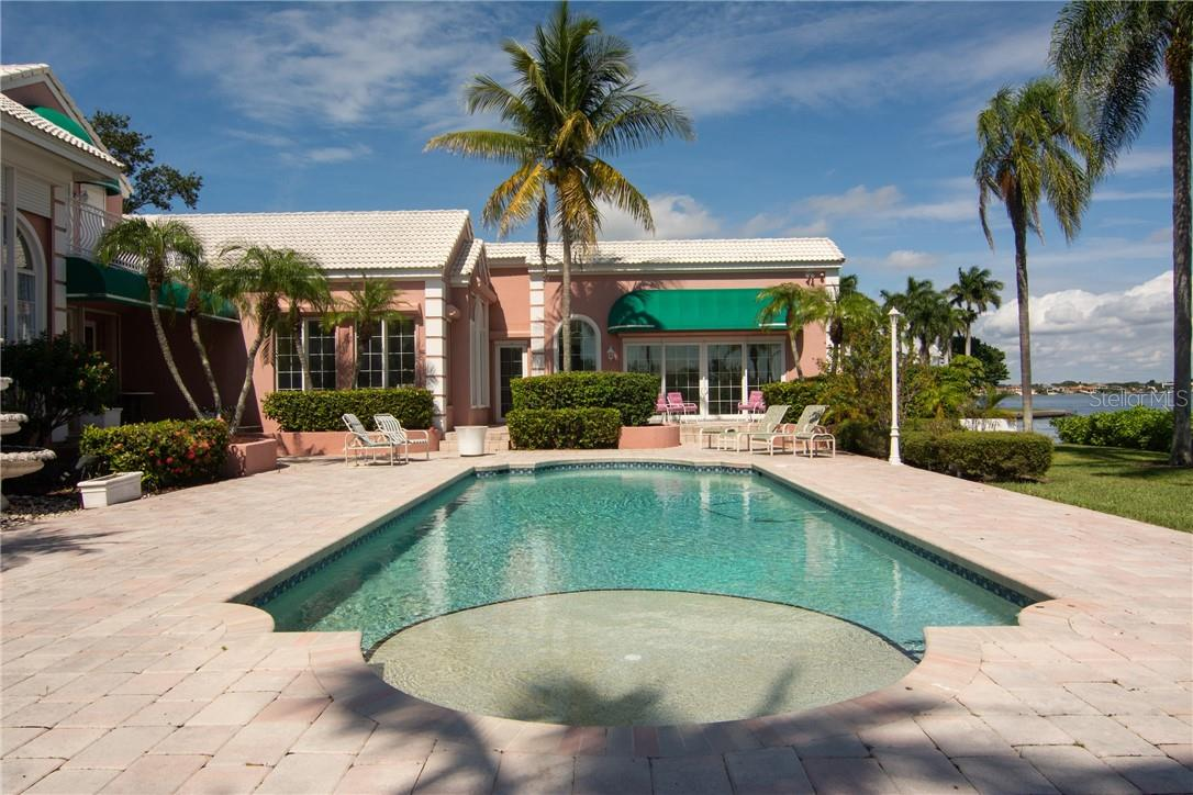 Pool looking towards cabana. - Single Family Home for sale at Address Withheld, Sarasota, FL 34242 - MLS Number is A4483403