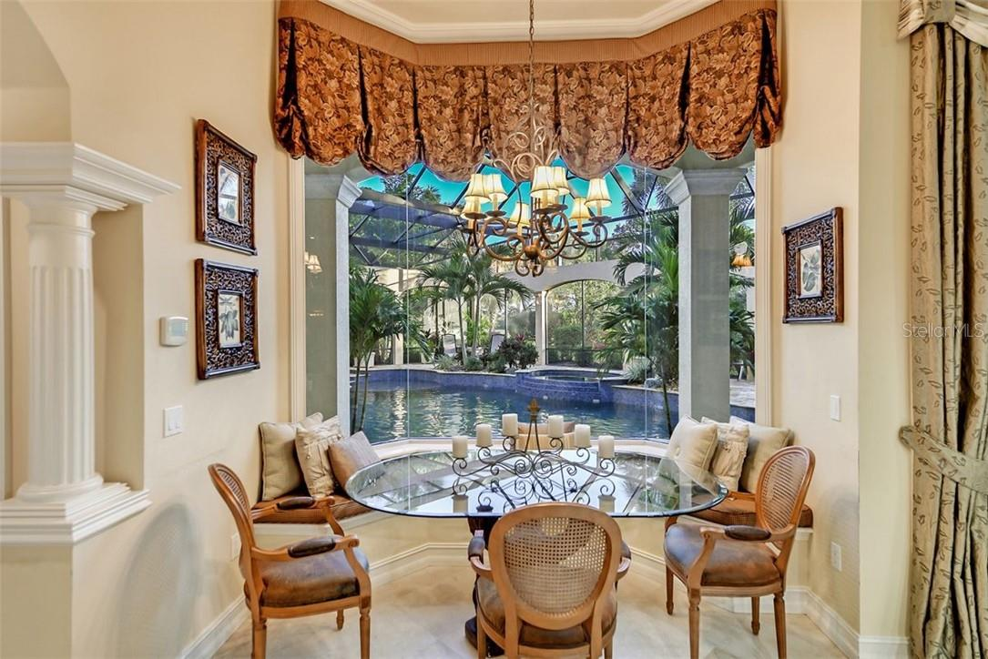 The cafe room to enjoy many casual breakfasts or lunches, a cozy space to watch your synchronized swimmers. - Single Family Home for sale at 8263 Archers Ct, Sarasota, FL 34240 - MLS Number is A4483993
