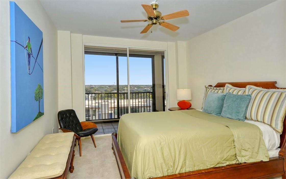 Guest Bedroom with city views and balcony access. - Condo for sale at 707 S Gulfstream Ave #1002, Sarasota, FL 34236 - MLS Number is A4484781