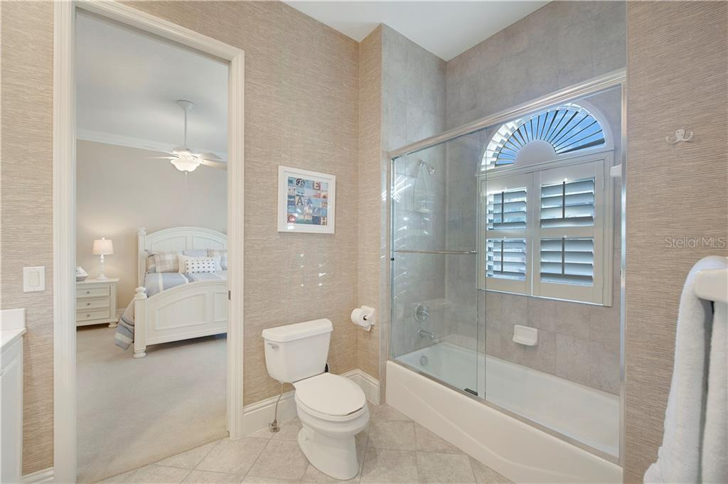 Jack-and-Jill bathroom between bedrooms 2 & 3 - Single Family Home for sale at 13223 Palmers Creek Ter, Lakewood Ranch, FL 34202 - MLS Number is A4484826