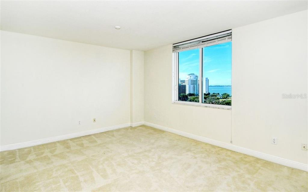 From the family room looking toward the living room - Condo for sale at 800 N Tamiami Trl #1007, Sarasota, FL 34236 - MLS Number is A4485565
