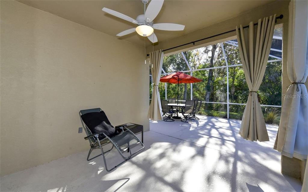 Screened lanai with covered area. - Villa for sale at 4812 Lakescene Pl, Sarasota, FL 34243 - MLS Number is A4486070