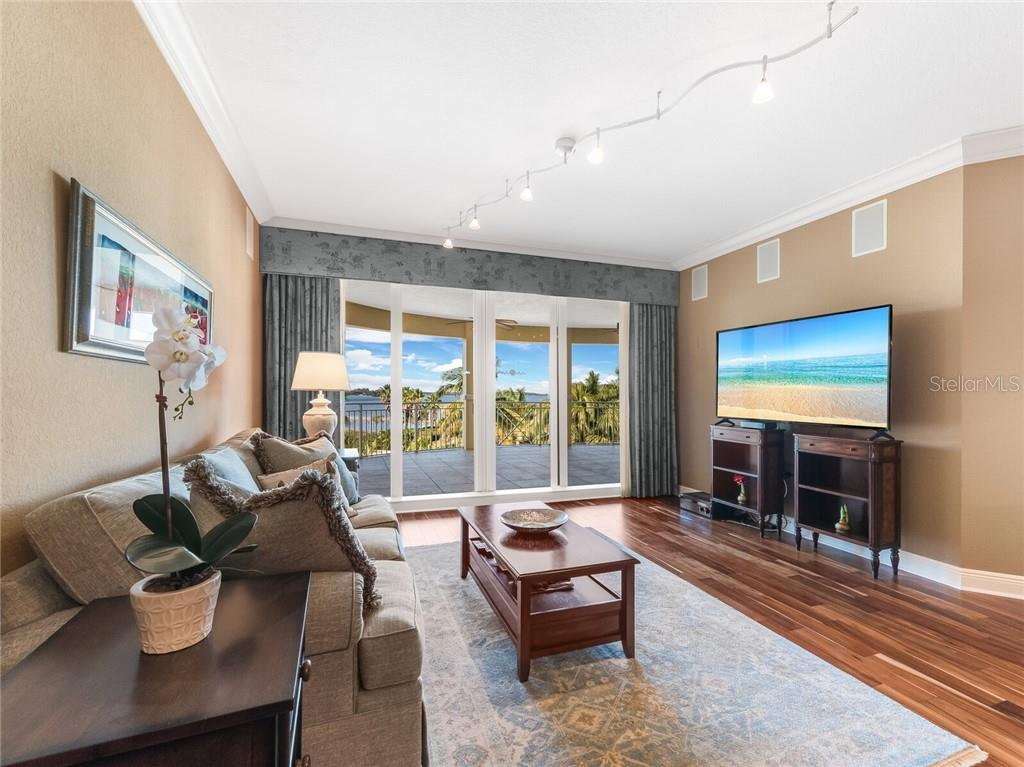 Expansive terrace off living room and owners suite. - Condo for sale at 14021 Bellagio Way #407, Osprey, FL 34229 - MLS Number is A4487552