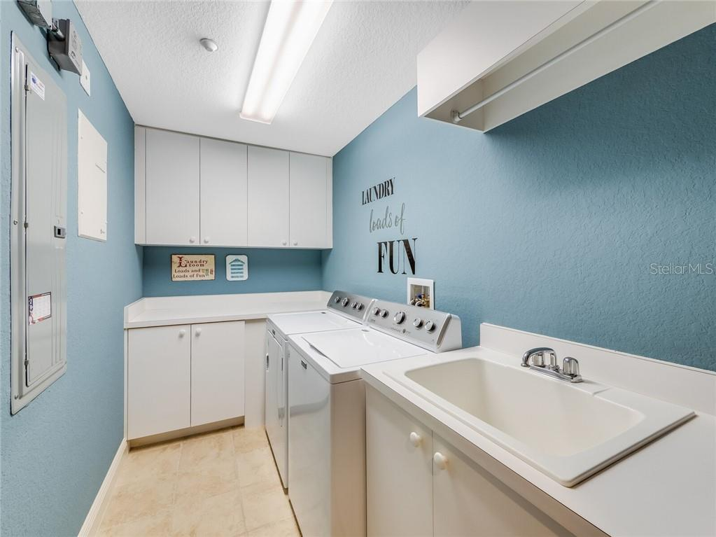 Dedicated laundry area inside the penthouse. - Condo for sale at 14021 Bellagio Way #407, Osprey, FL 34229 - MLS Number is A4487552