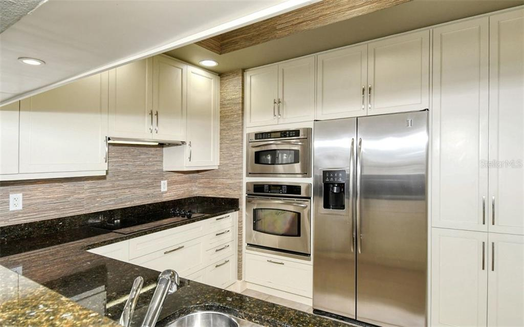Kitchen with stainless steel appliances and plentiful storage - Condo for sale at 50 Central Ave #14b, Sarasota, FL 34236 - MLS Number is A4487974