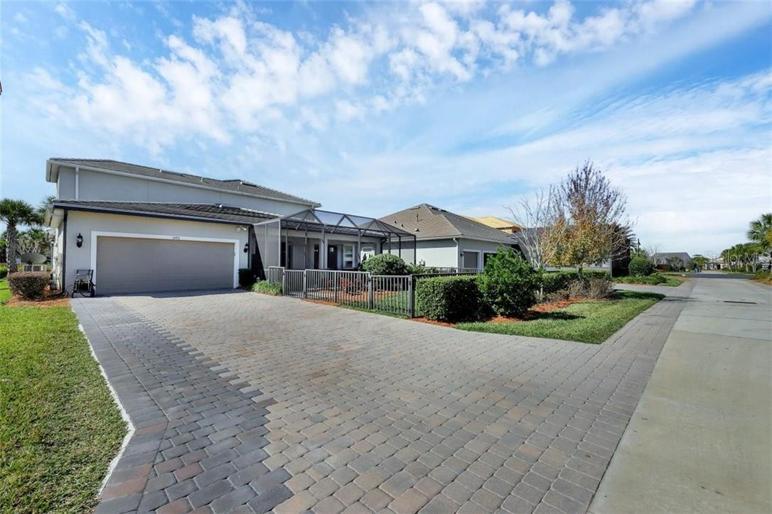 Additional paver added to the driveway for guest parking.  Epoxy finish on the garage floor. - Single Family Home for sale at 11713 Blue Hill Trl, Bradenton, FL 34211 - MLS Number is A4490622