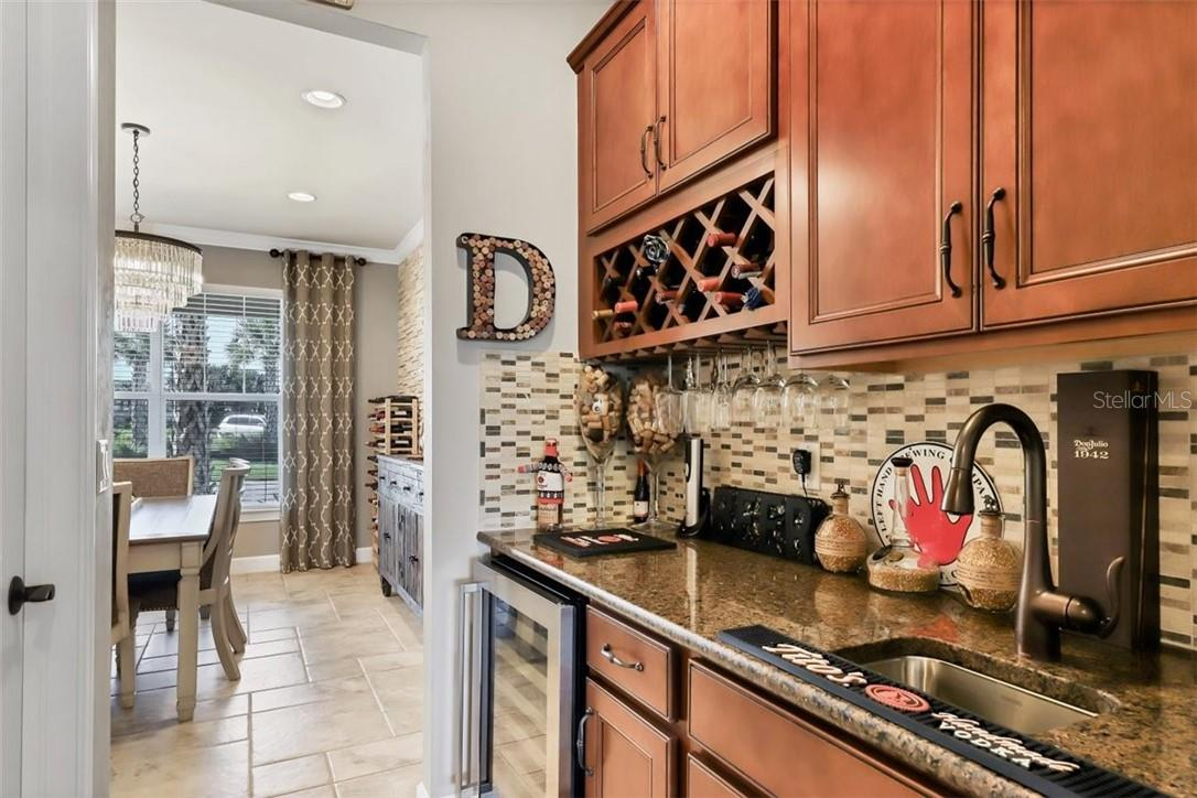 Butler pantry with wine cooler and wet bar. - Single Family Home for sale at 11713 Blue Hill Trl, Bradenton, FL 34211 - MLS Number is A4490622