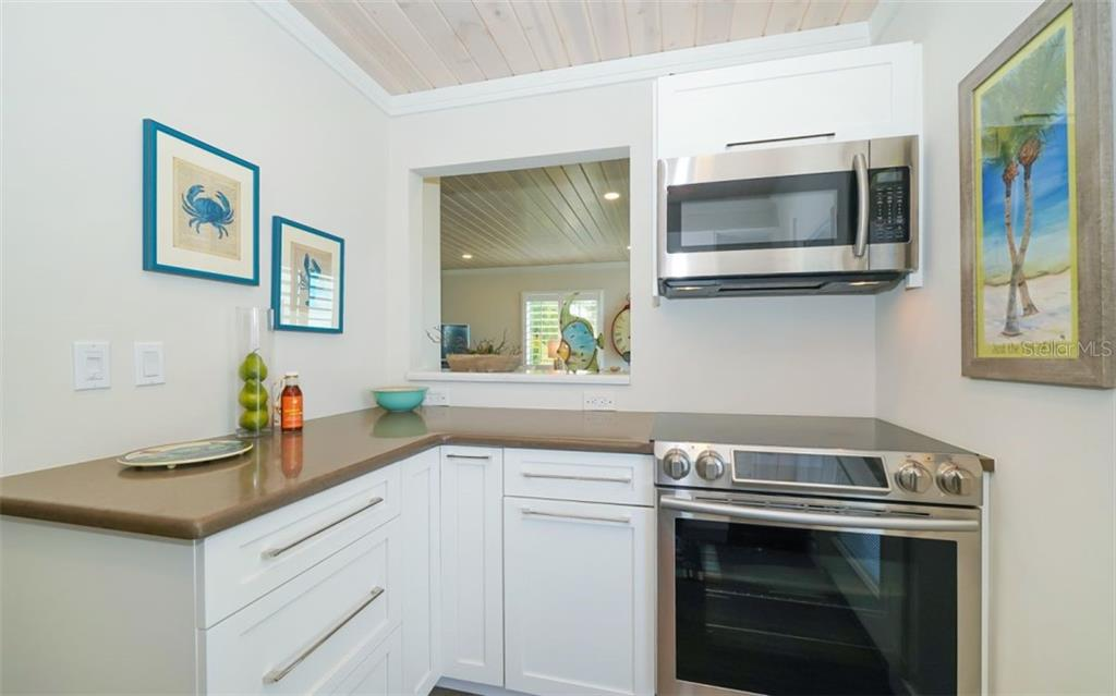 Newer stainless steel appliances; easy care solid surface counters - Condo for sale at 761 John Ringling Blvd #28, Sarasota, FL 34236 - MLS Number is A4490945