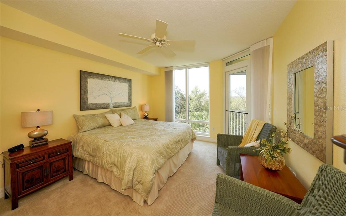 Master suite with floor to ceiling windows and access to screened balcony - Condo for sale at 409 N Point Rd #402, Osprey, FL 34229 - MLS Number is A4491620