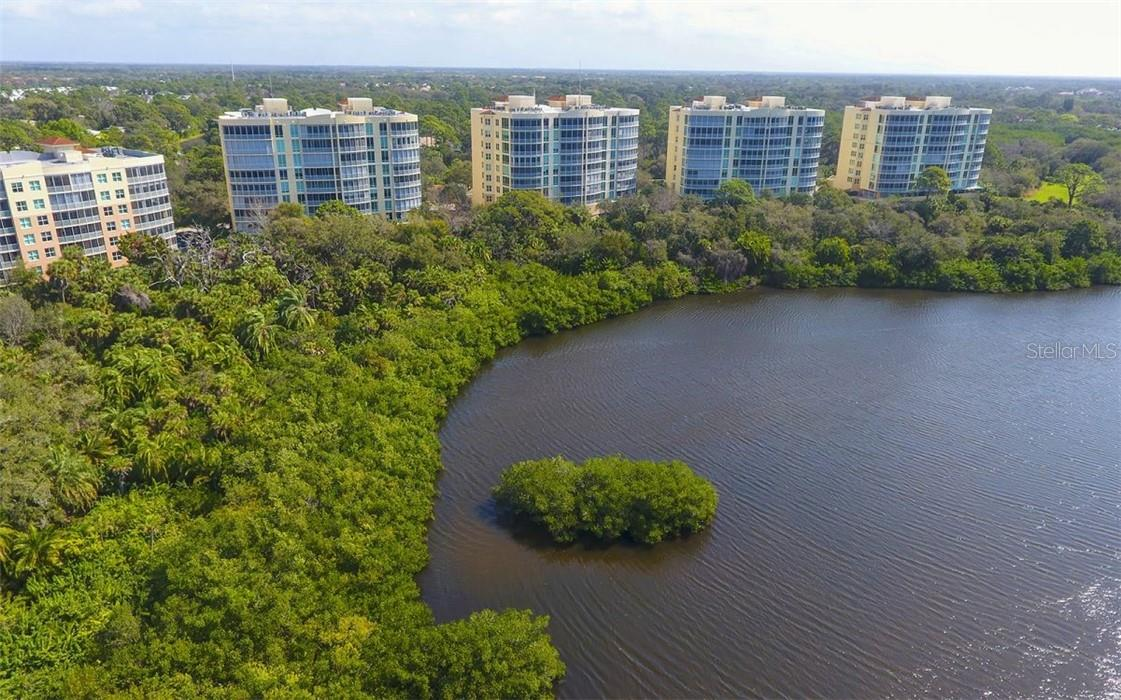 Aerial view of the Meridian - Condo for sale at 409 N Point Rd #402, Osprey, FL 34229 - MLS Number is A4491620