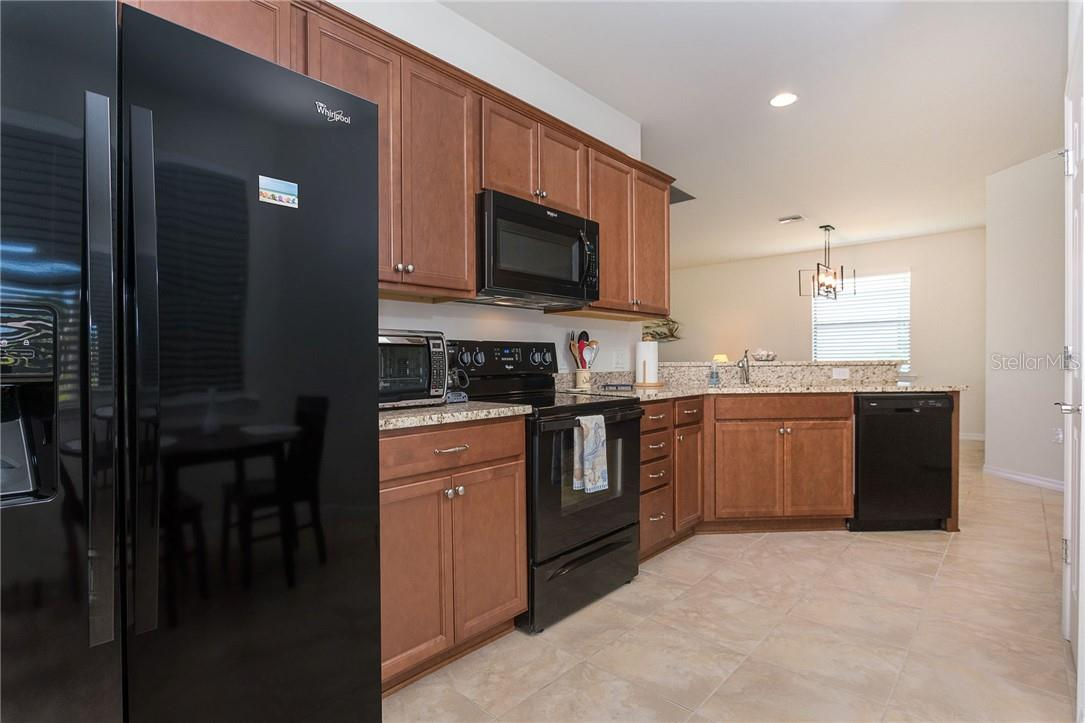 Kitchen flows to the open lay out of this villa - Villa for sale at 13883 Botteri St, Venice, FL 34293 - MLS Number is A4493523