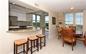 Breakfast bar and Dining Room with views - Condo for sale at 1701 Gulf Of Mexico Dr #505, Longboat Key, FL 34228 - MLS Number is A4170632