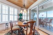 A separate dining room opens to a wonderful private screened porch with a view! - Condo for sale at 318 Bay Dr S #7, Bradenton Beach, FL 34217 - MLS Number is A4178742