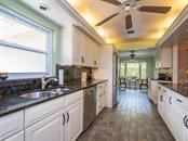 Kitchen - Single Family Home for sale at 319 Bob White Way, Sarasota, FL 34236 - MLS Number is A4184394
