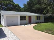 One car garage plus extra parking spaces. - Single Family Home for sale at 938 Highland St, Sarasota, FL 34234 - MLS Number is A4186423