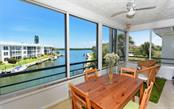Great Room overlooking pool area with great Bay Views. - Condo for sale at 4330 Falmouth Dr #307, Longboat Key, FL 34228 - MLS Number is A4187329